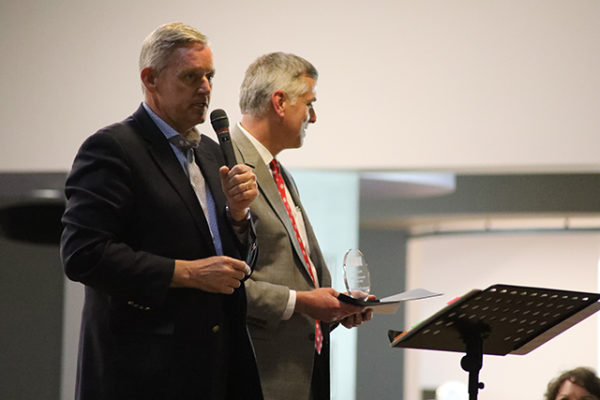 Dale Heydlauff, left, Senior Vice President of Corporate Communications at American Electric Power and President of the American Electric Power Foundation, accepts the Corporate Leadership Spirit Award on behalf of AEP from LifeCare Alliance Board President Kent Hess at the LifeCare Alliance Volunteer Recognition event on Monday, April 30, 2018. Photo by Anthony Clemente, LifeCare Alliance.