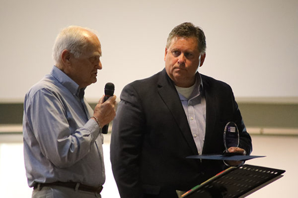 Everett Meidell, left, accepts the John Nilssen Memorial Spirit Award from LifeCare Alliance Board Member Tom Skoog at the LifeCare Alliance Volunteer Recognition event on Monday, April 30, 2018. Photo by Anthony Clemente, LifeCare Alliance.