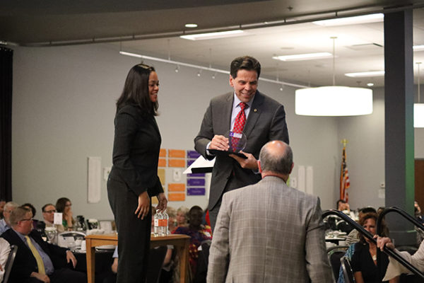 Ohio Dominican University President Robert Gervasi, right, accepts the Meals-on-Wheels School Spirit Award from Columbus City Council Member Jaiza Page at the LifeCare Alliance Volunteer Recognition event on Monday, April 30, 2018. Photo by Anthony Clemente, LifeCare Alliance.