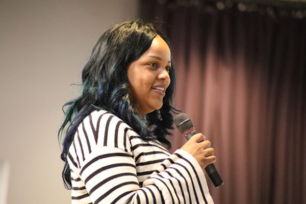Talia Givens-Gore of Beacon Property Management accepts the Harriett Goodspeed Spirit Award on behalf of Jack DeBaar and Joseph Seifert at the LifeCare Alliance Volunteer Recognition event on Monday, April 30, 2018. Photo by Anthony Clemente, LifeCare Alliance.