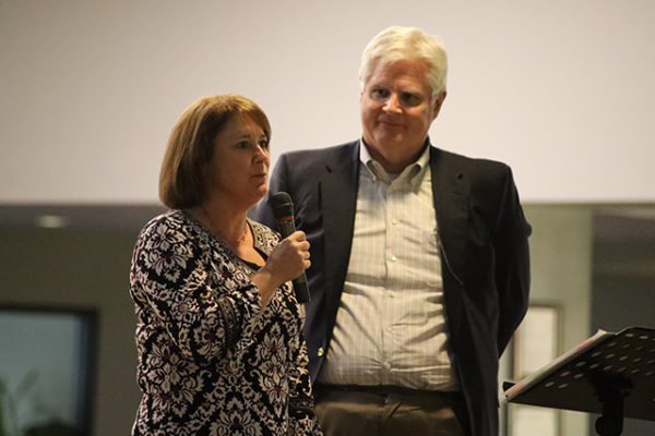 Kelly Hollis accepts the Outstanding Spirit Award from LifeCare Alliance Board Member Phil Barker of KPMG at the LifeCare Alliance Volunteer Recognition event on Monday, April 30, 2018. Photo by Anthony Clemente, LifeCare Alliance.