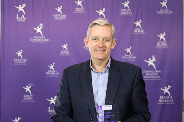 Dale Heydlauff, Senior Vice President of Corporate Communications at American Electric Power and President of the American Electric Power Foundation, poses with the Corporate Leadership Spirit Award at the LifeCare Alliance Volunteer Recognition event on Monday, April 30, 2018. Photo by Andrew Zuk, LifeCare Alliance.