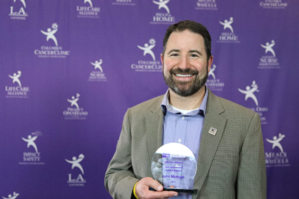 John McHugh poses with the Advancement Spirit Award at the LifeCare Alliance Volunteer Recognition event on Monday, April 30, 2018. Photo by Andrew Zuk, LifeCare Alliance.