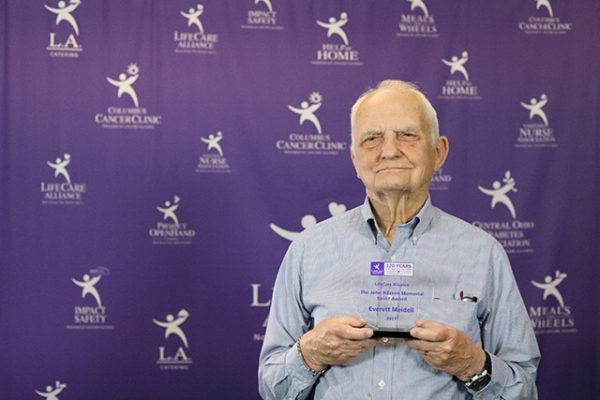 Everett Meidell poses with the John Nilssen Memorial Spirit Award at the LifeCare Alliance Volunteer Recognition event on Monday, April 30, 2018. Photo by Andrew Zuk, LifeCare Alliance.
