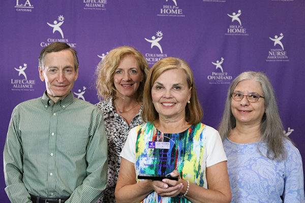 Volunteers from of Temple Beth Shalom pose with the Frank Stoddard Raper Spirit Award at the LifeCare Alliance Volunteer Recognition event on Monday, April 30, 2018. Photo by Andrew Zuk, LifeCare Alliance.
