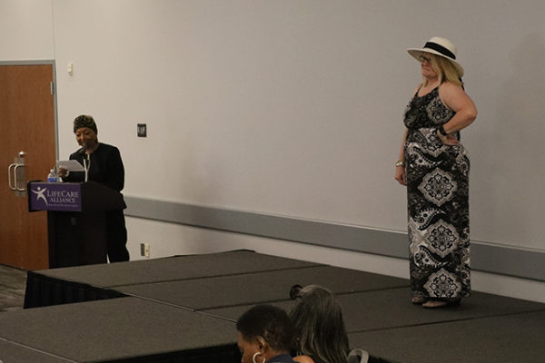 A LifeCare Alliance employee walks the runway during the Spring Style Show on Wednesday, June 6, 2018. (Photo by Anthony Clemente, LifeCare Alliance)