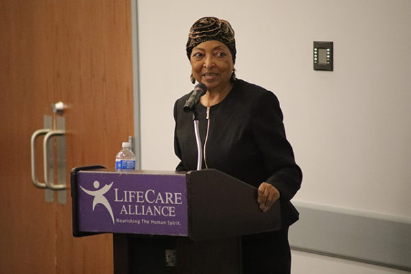 Sandi Taylor emcees at the Spring Style Show on Wednesday, June 6, 2018. (Photo by Anthony Clemente, LifeCare Alliance)