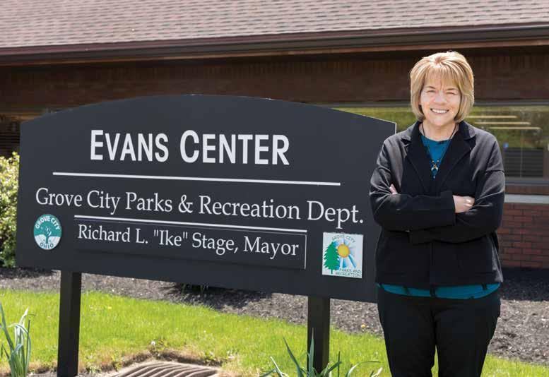 Dedra Thompson standing in front of Evans Center sign.