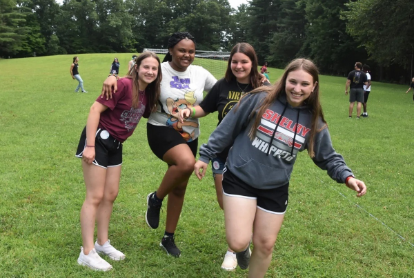 Four teenage female campers pose for a photo at Camp Hamwi